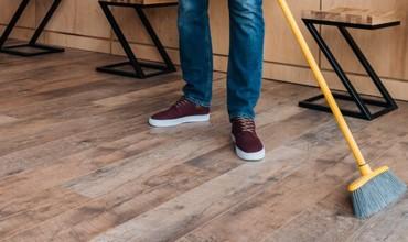 sweeping hardwood flooring | Tom January Floors