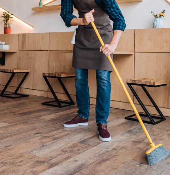 Sweeping hardwood floor | Tom January Floors