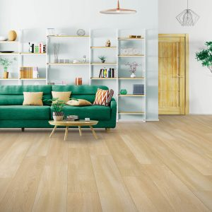 Green couch on Laminate floor | Tom January Floors