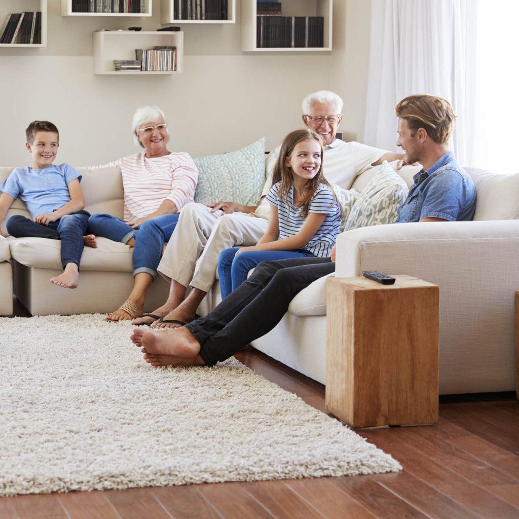 Family enjoying in living room   Tom January Floors